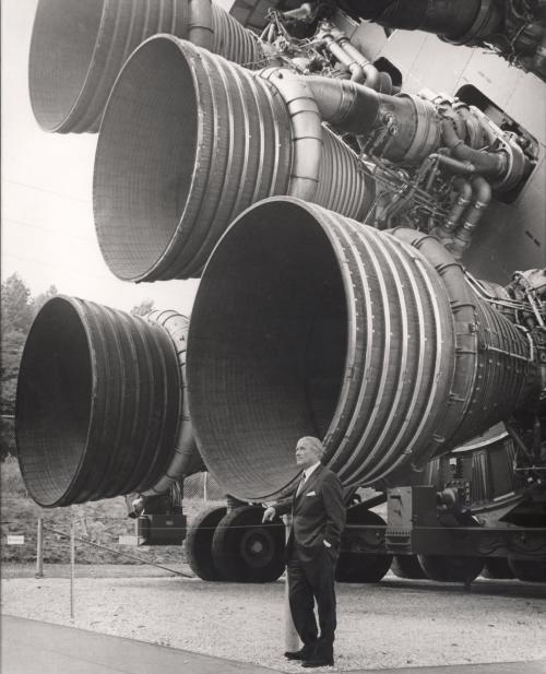 Wernher von Braun next to 5 F-1 engines